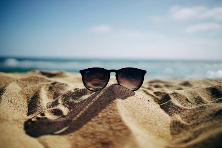 Close-up of sunglasses at a beach