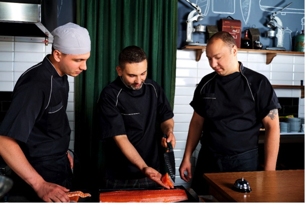 Three chefs in a training session