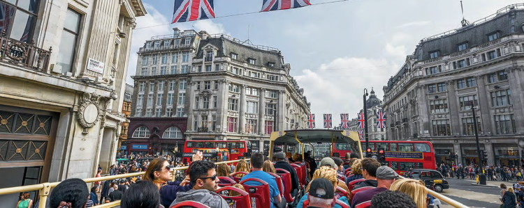 Visitors on a tourist bus in London