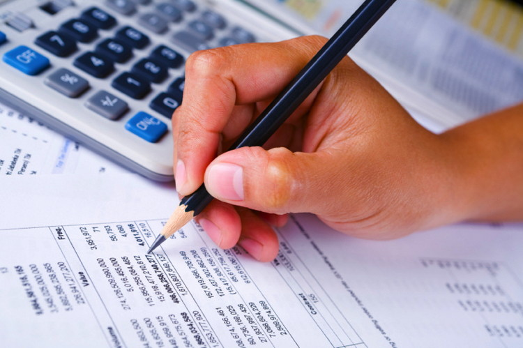 A man reviewing a financial statement
