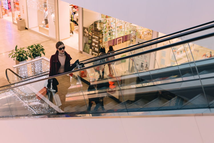 An escalator in a shopping mall - Photo by freestocks.org on Unsplash