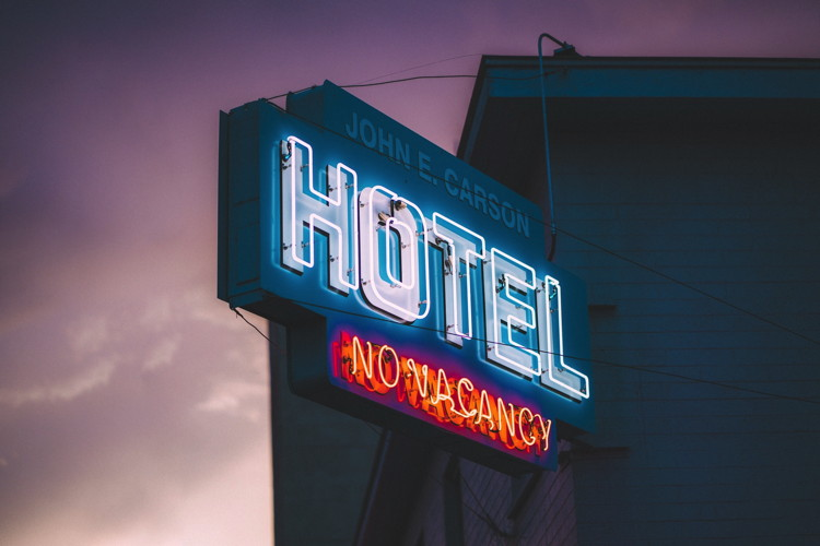 Hotel No Vacany sign - Photo by KEEM IBARRA on Unsplash