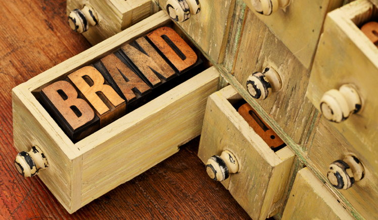 The word 'brand' made out of wood