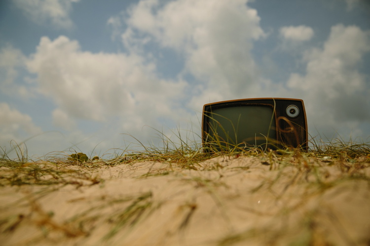 An old TV set on a beach - Photo by Pablo Garcia Saldaña on Unsplash