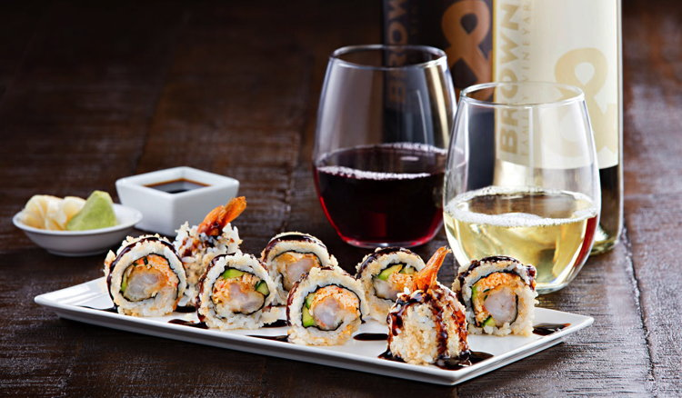 P.F. Chang's sushi roll and wine glasses