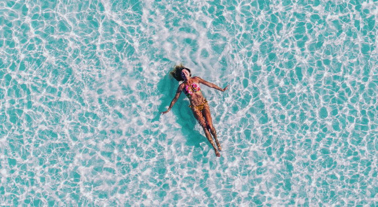 A woman in the pool at Sun Island Resort, Alif Dhaal Atoll, Maldives - Photo by Ishan @seefromthesky on Unsplash