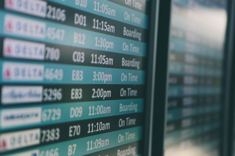 An airport departe board - Photo by Matthew Smith on Unsplash