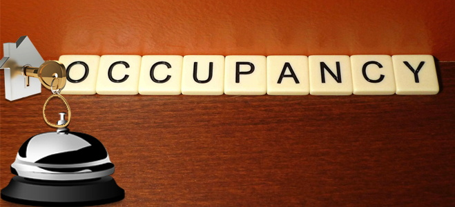 Scrabble letters spelling the word occupancy