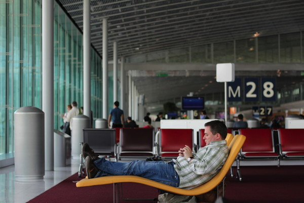 A man sitting in an airport terminal