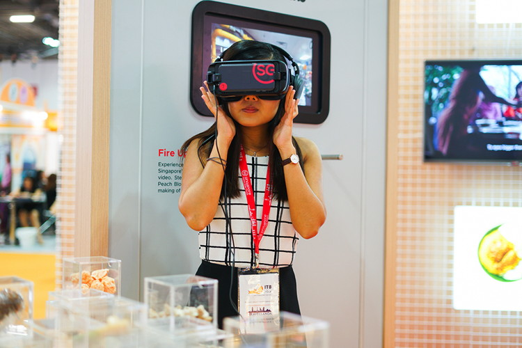 A woman using VR goggles at ITB Asia