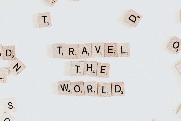 Scrabble tiles spelling 'Travel The World' - Photo by Priscilla Du Preez on Unsplash