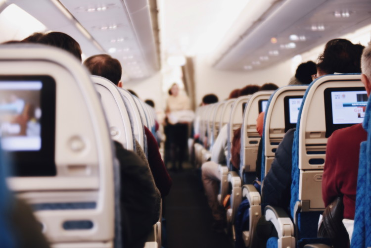 Passengers on an airplane - Photo by Suhyeon Choi on Unsplash