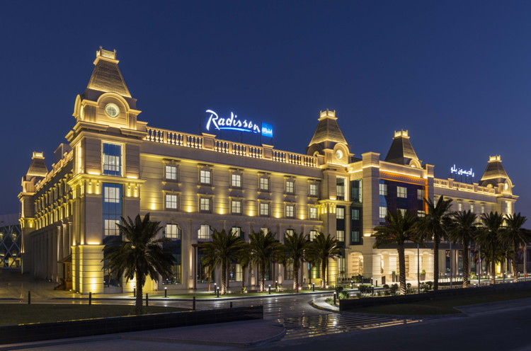 Radisson Blu Hotel Ajman - Exterior at night