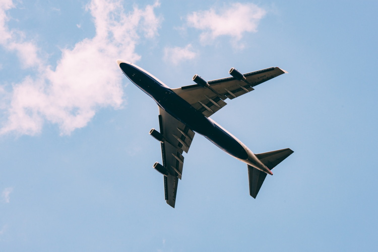 An airplane in the sky - Photo by Jordan Sanchez on Unsplash