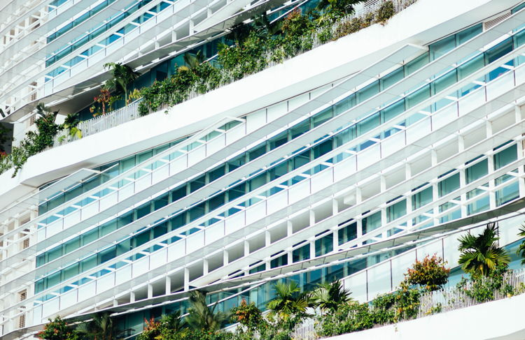 Modern hotel exterior with plants - Photo by chuttersnap on Unsplash