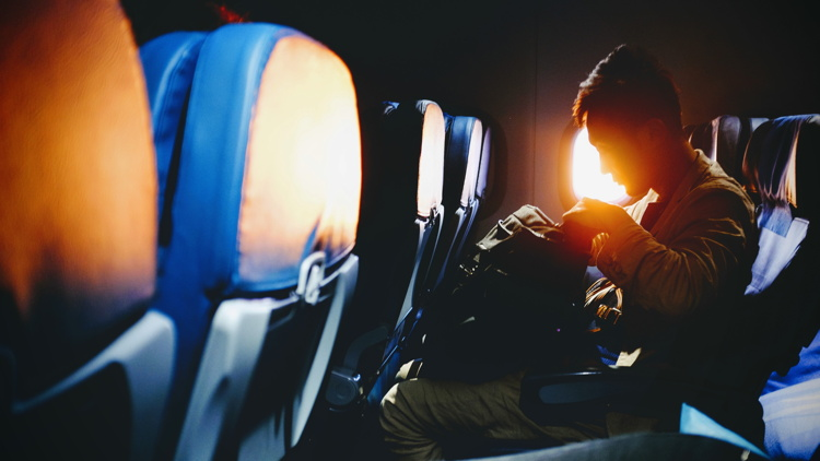 A passenger on an airplane - Photo by Bambi Corro on Unsplash