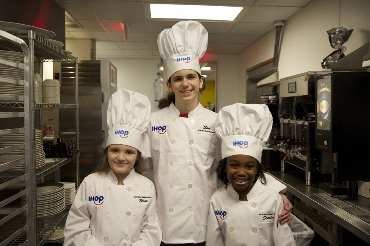 The first IHOP Kid Culinary Team visits the IHOP Test Kitchen Friday, February 16 to cook their own pancake creations alongside Chef Nevielle Panthaky, VP of Culinary, IHOP (from left: Elise Bromund,