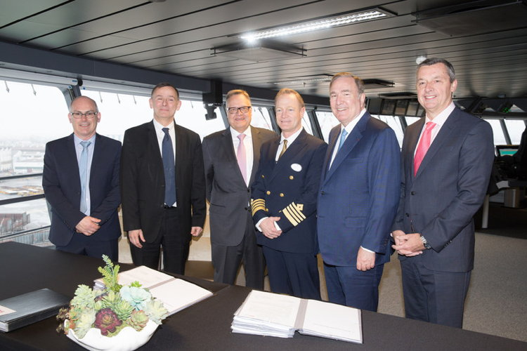 Left to right: Jean-Yves Jaouen, COO, and Laurent Castaing, General Manager, STX France; Richard D. Fain, Chairman & CEO, Royal Caribbean Cruises Ltd.; Michael Bayley, President & CEO, Royal Caribbean