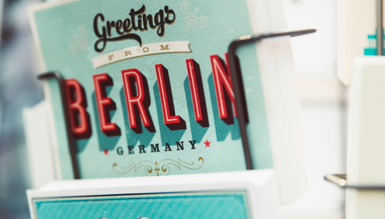 Colorful postcards from Berlin in a stand - Photo by Markus Spiske on Unsplash