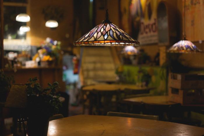 Inside of a restaurant - Photo by Ehud Neuhaus on Unsplash