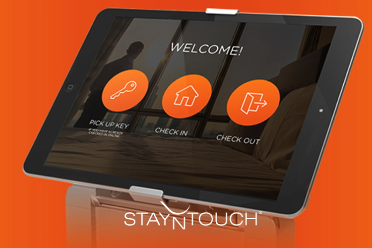 A tablet with the StayNTouch logo