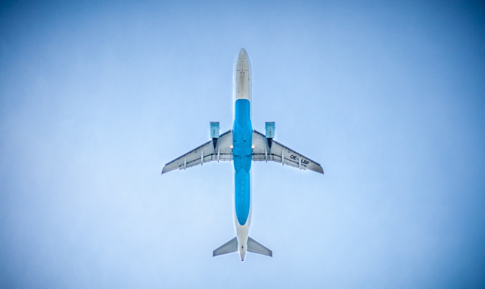 Airplane in the air - Photo by Deniz Altindas on Unsplash