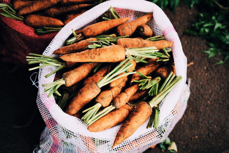 A bag of organic carrots - Photo by Thomas Gamstaetter on Unsplash