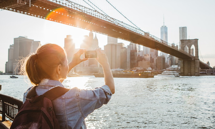 A woman taking a photo in NYC