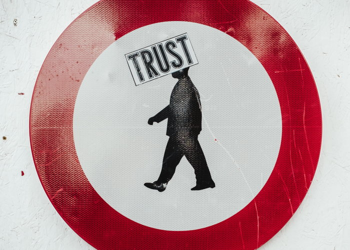 A traffic sign with the word Trust - Photo by Bernard Hermant on Unsplash