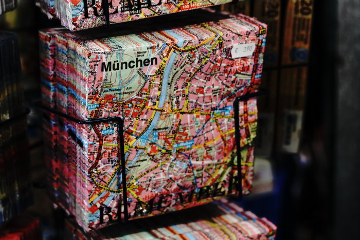 A pack of napkins with the map of Munich printed on them in a souvenir store - Photo by Camilla Bundgaard on Unsplash
