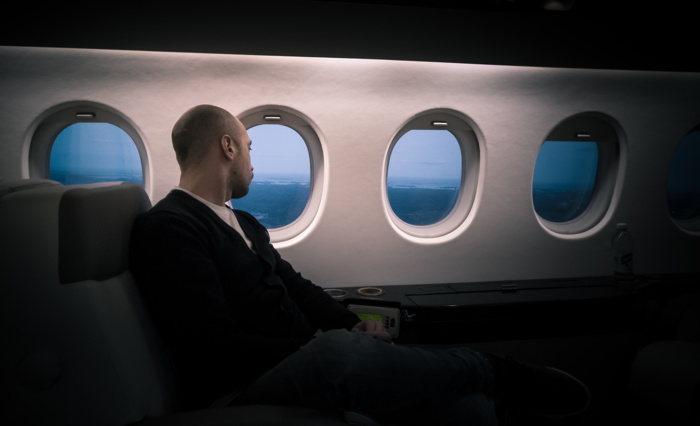 A man in first class on an airplane - Photo by Joakim Honkasalo on Unsplash