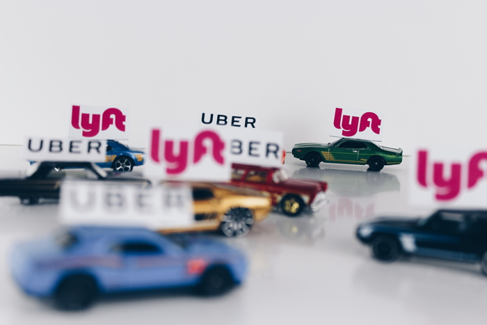The ride-sharing wars! Uber and Lyft conceptual road concept using toy cars - Photo by Thought Catalog on Unsplash