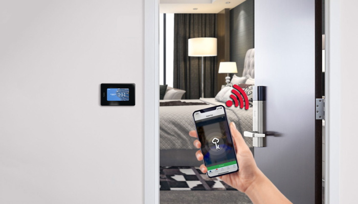A hotel room with a mobile phone opening the door