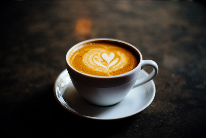 A coffee with heart shaped foam - Photo by Danijela Froki on Unsplash