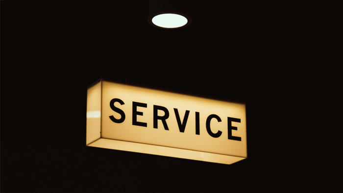 A service sign in a room lit up at night - Photo by Mike Wilson on Unsplash