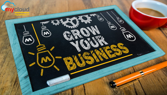 A tablet with the words - Grow Your Business