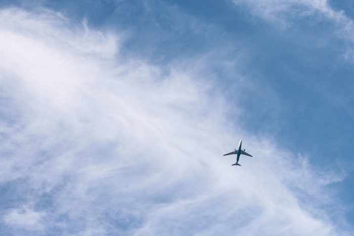 An airplane in the sky - Photo by E T T T O on Unsplash