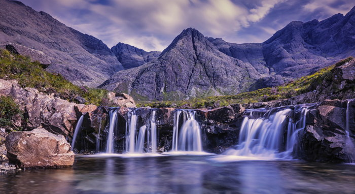 Waterfalls in Skye, United Kingdom - Photo by Robert Lukeman on Unsplash
