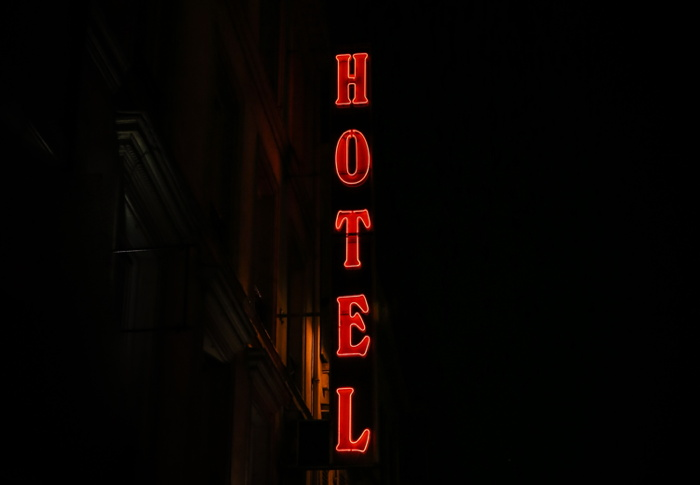 A hotel sign - Photo by Alexandre Godreau on Unsplash