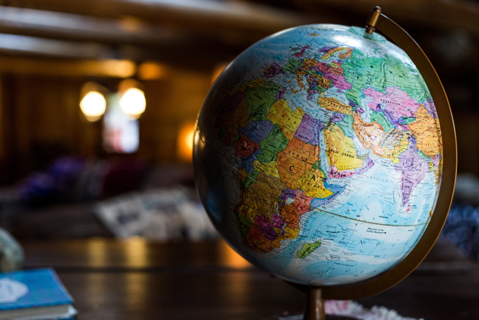 desk globe on table - Photo by Kyle Glenn on Unsplash