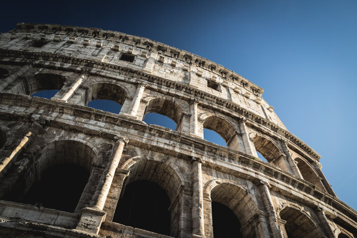 Low angle photo of The Colosseum in Rome - Photo by Patrick Schneider on Unsplash