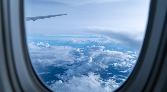 white clouds through an airplane window at daytime - Photo by Paolo Nicolello on Unsplash