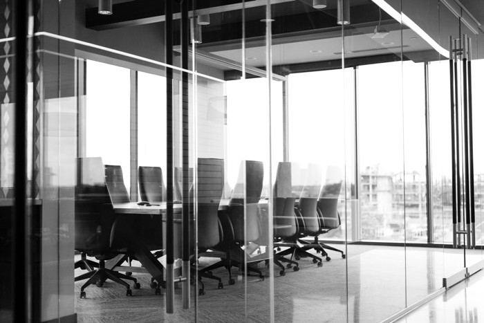grayscale photography of corporate room - Photo by Drew Beamer on Unsplash