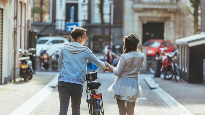 A young couple with bicycle - Source Booking.com
