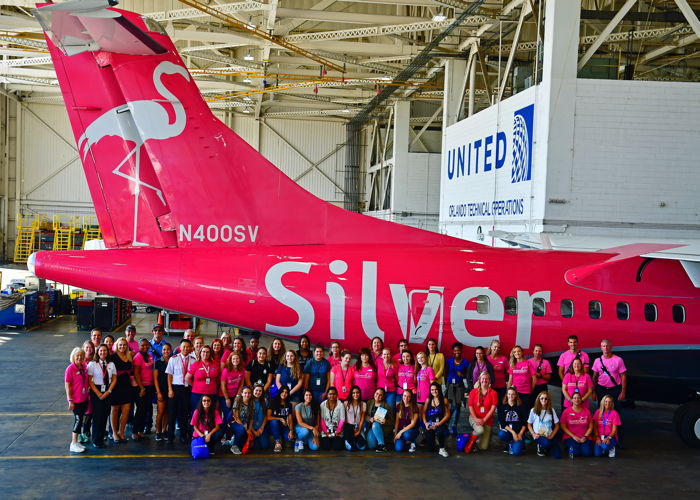Students in front of a Silver Airways airplane