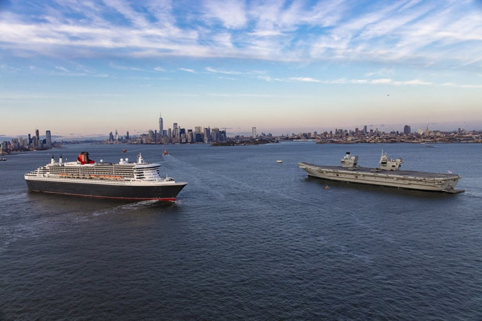 Cunard's ocean liner Queen Mary 2 greets the Royal Navy aircraft carrier HMS Queen Elizabeth in the New York Harbor.