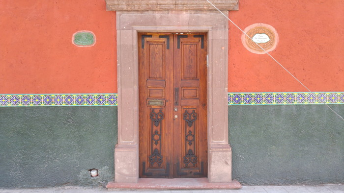 Brown wooden closed door in San Miguel de Allende, Mexico - Photo by Scott Tobin on Unsplash