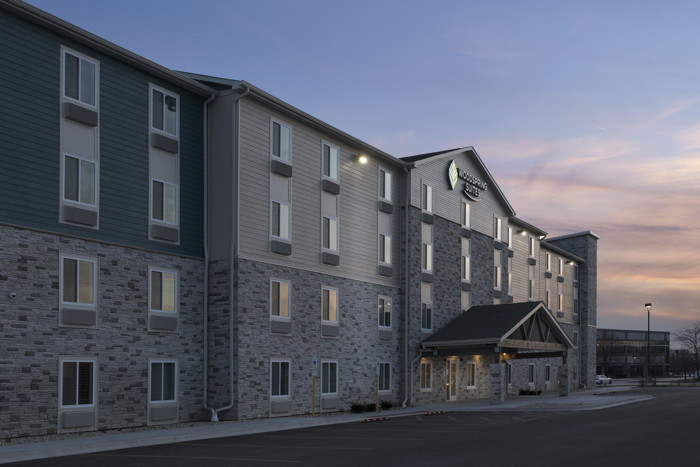 An unnamed Woodspring Suites hotel exterior