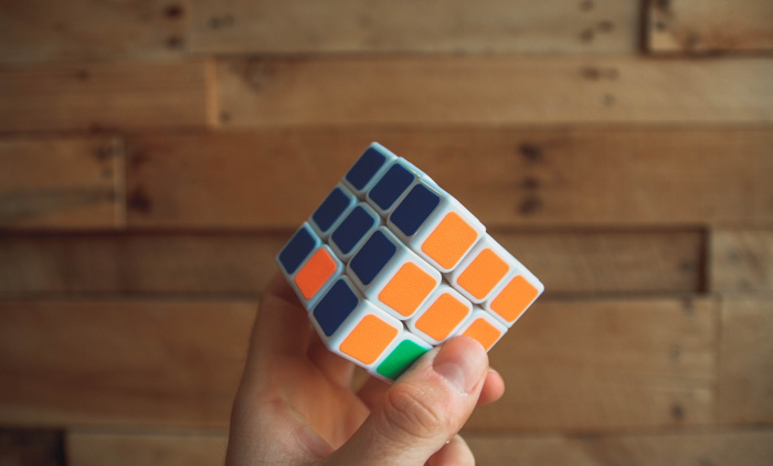 Person holding a Rubik's Cube - Photo by NeONBRAND on Unsplash