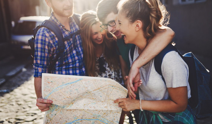 A group of young people looking at a map